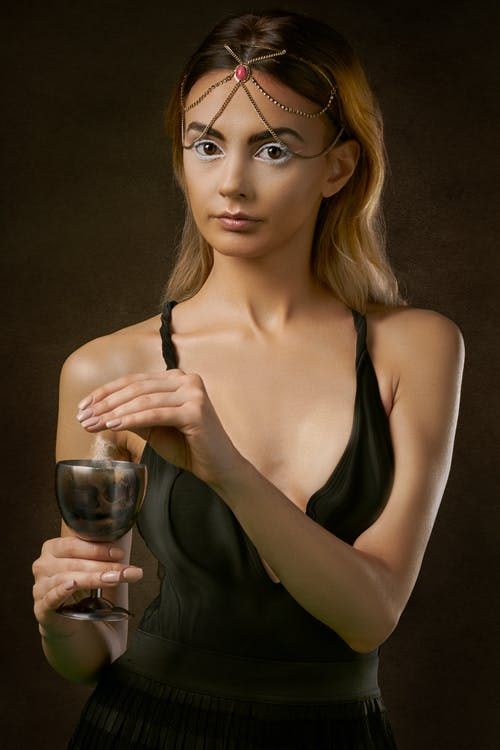 Woman Wearing Black Spaghetti-strap Dress Holding Wine Glass