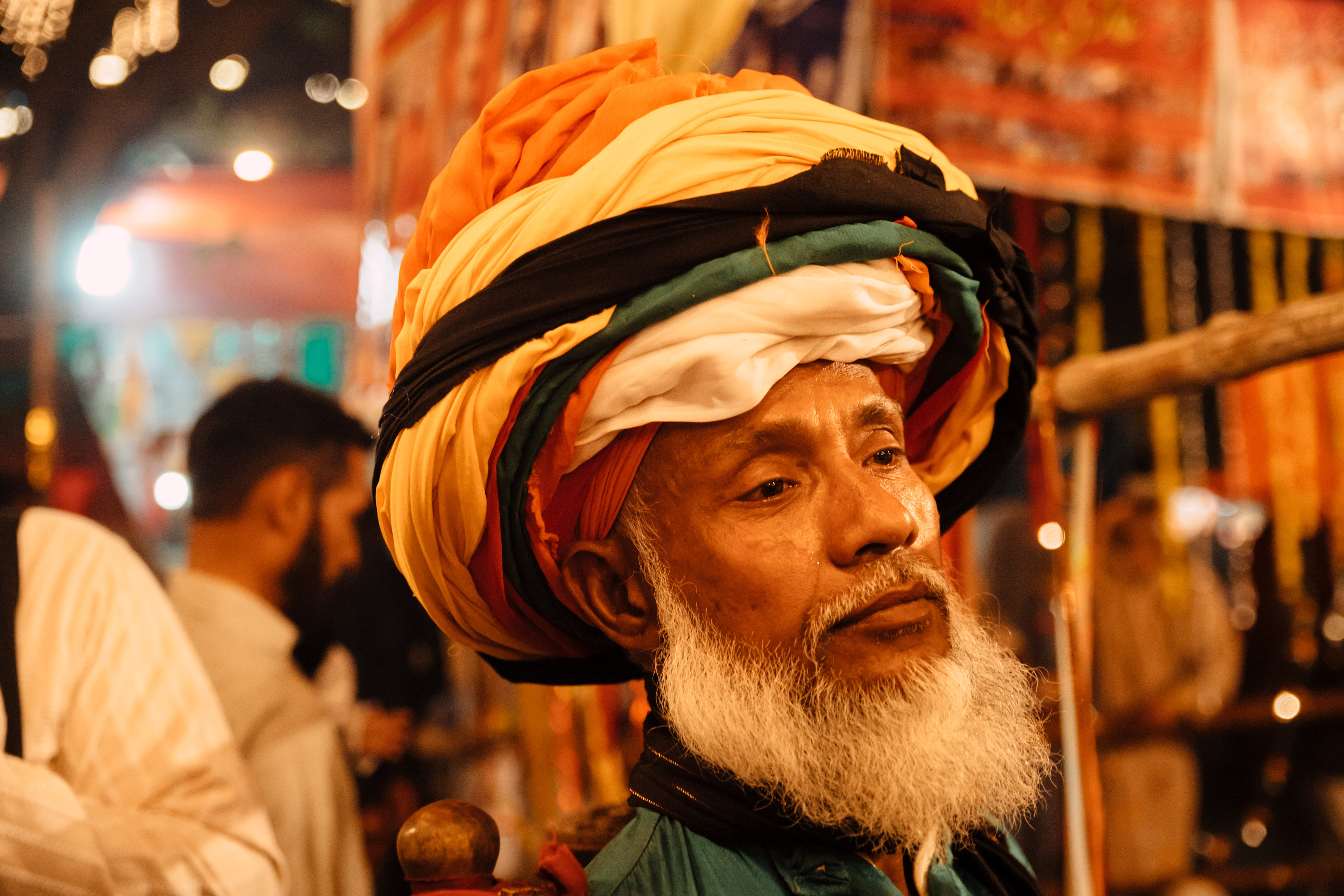 Man in an Orange, Yellow and Black Turban