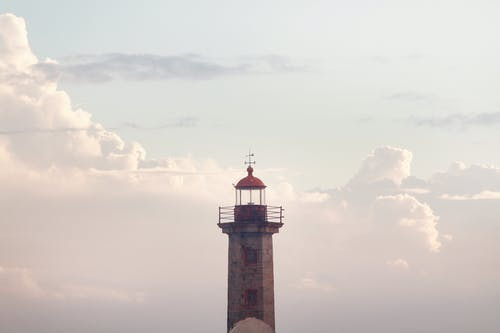 Selective Focus Photography Of Lighthouse