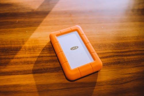 Orange Phone Case on Wooden Surface