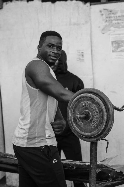 Man Holding Barbell