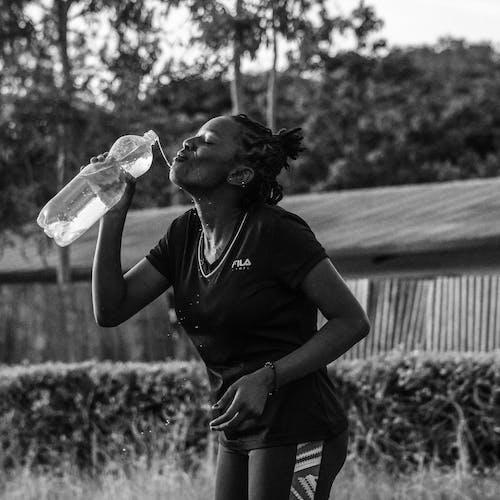 Woman Drinking Water On Bottle