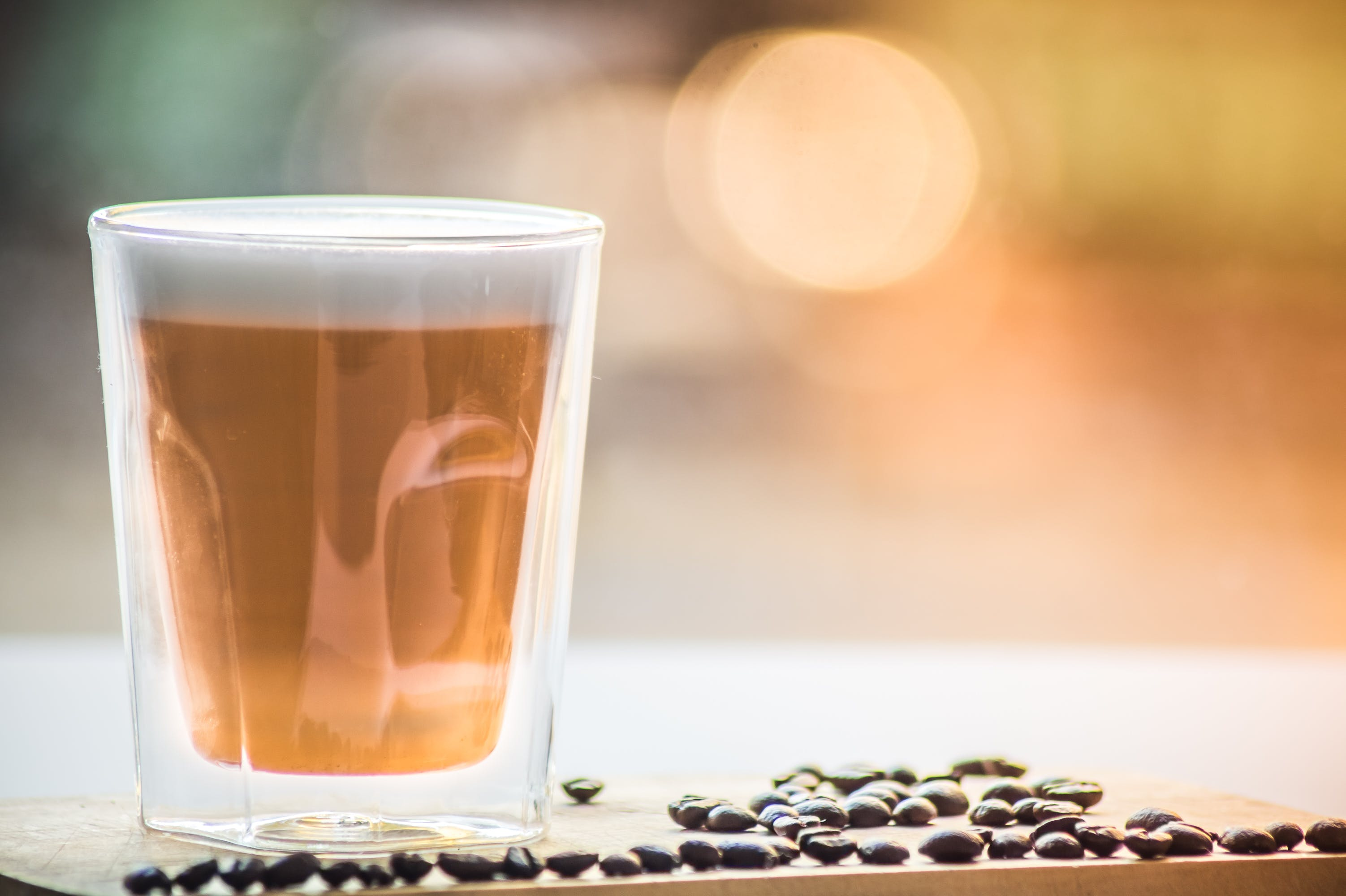 Coffee in Drinking Glass With Black Beans