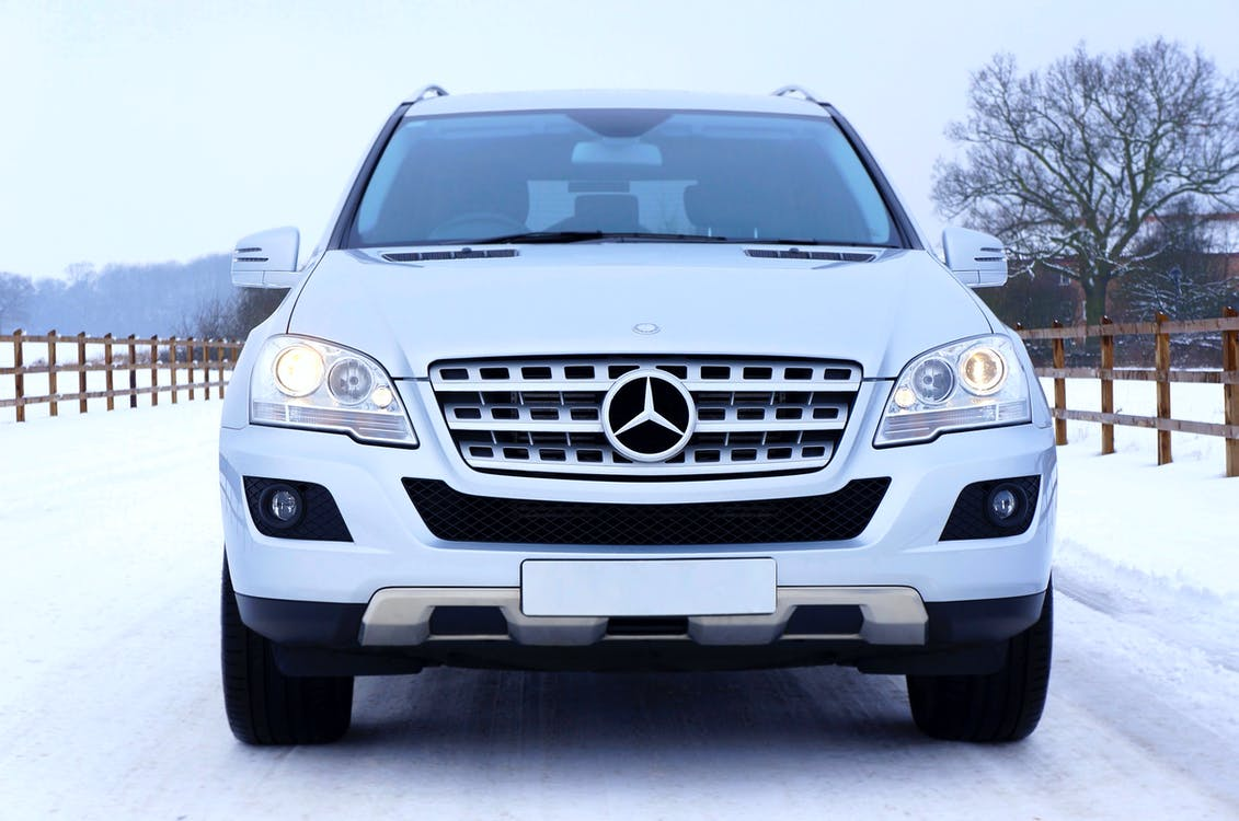 White Mercedes Benz Car on White Snow Covered Ground at Daytime