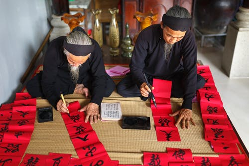 Man and Woman Doing Calligraphy