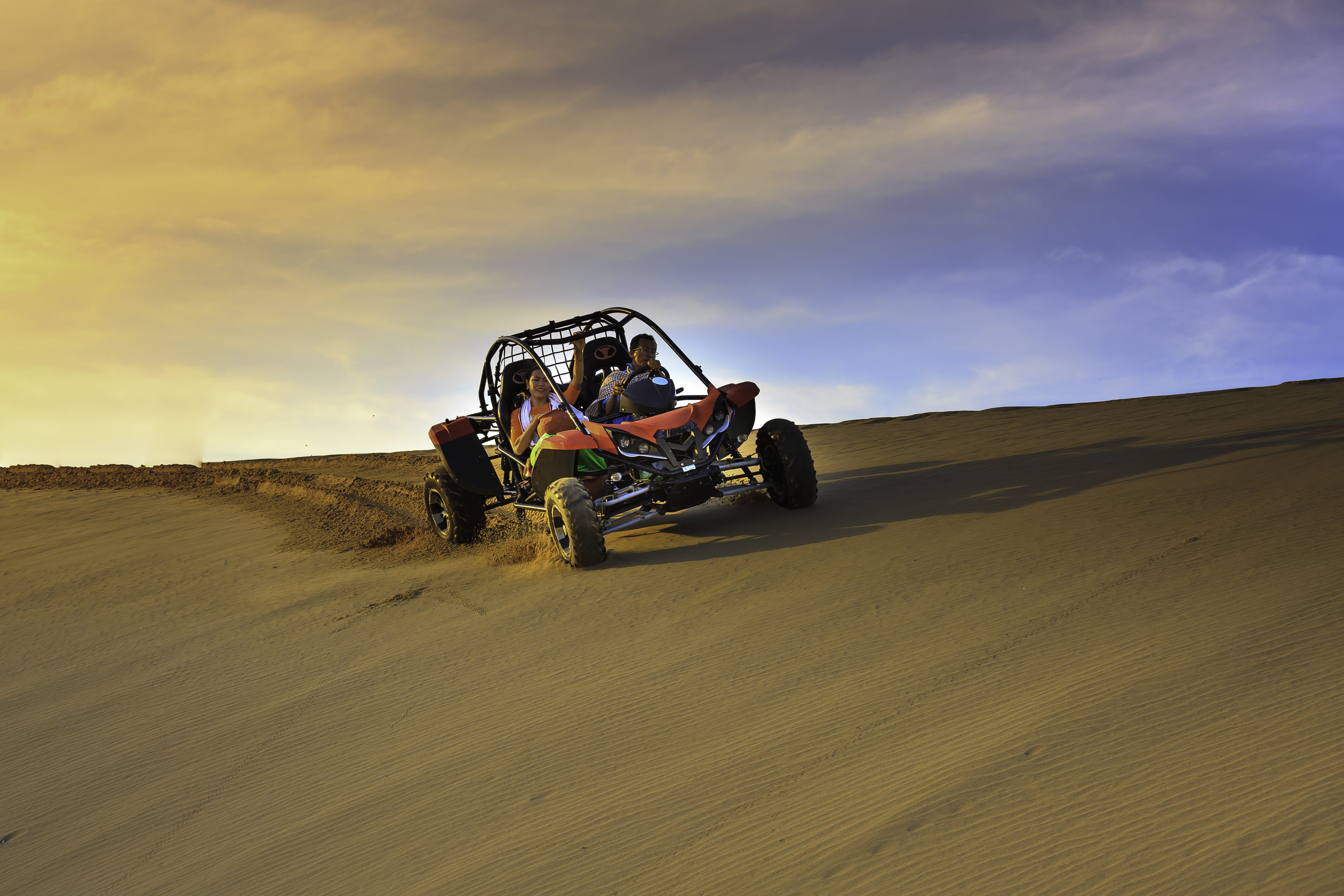 Person Riding Dune Buggy on Desert