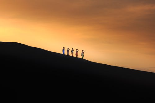 Five Persons Standing on Mountain