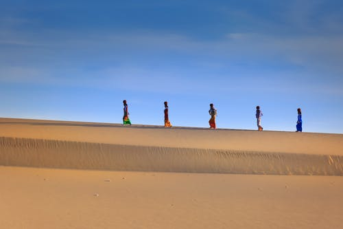 People Walking on Desert
