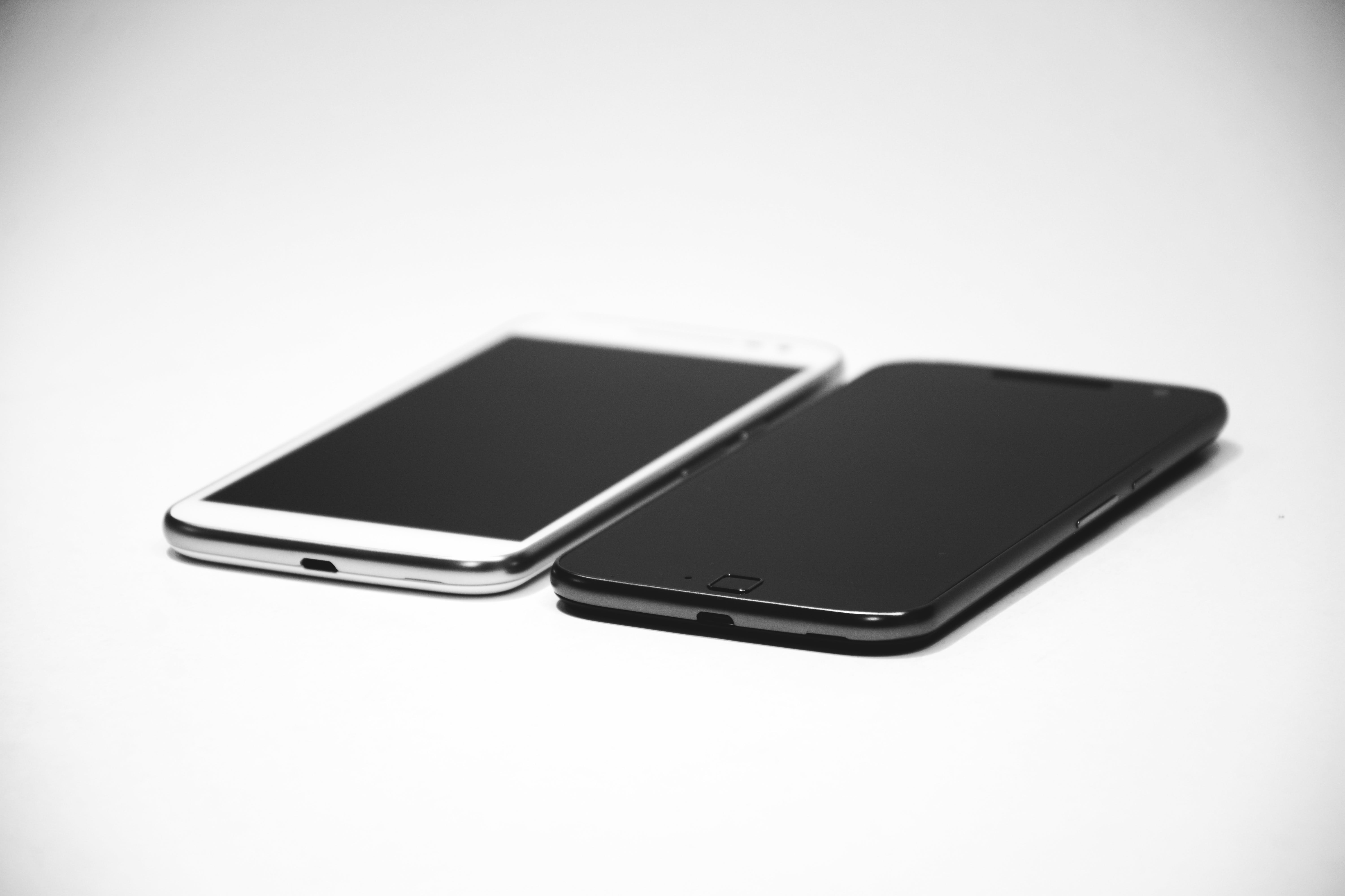 White Android Smartphone Near Black Android Smartphone
