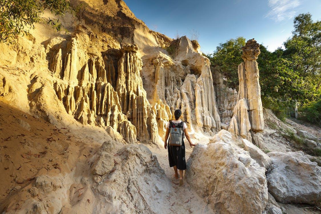 Woman Standing Near Rock Formation