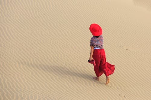 Woman Walking on Sands