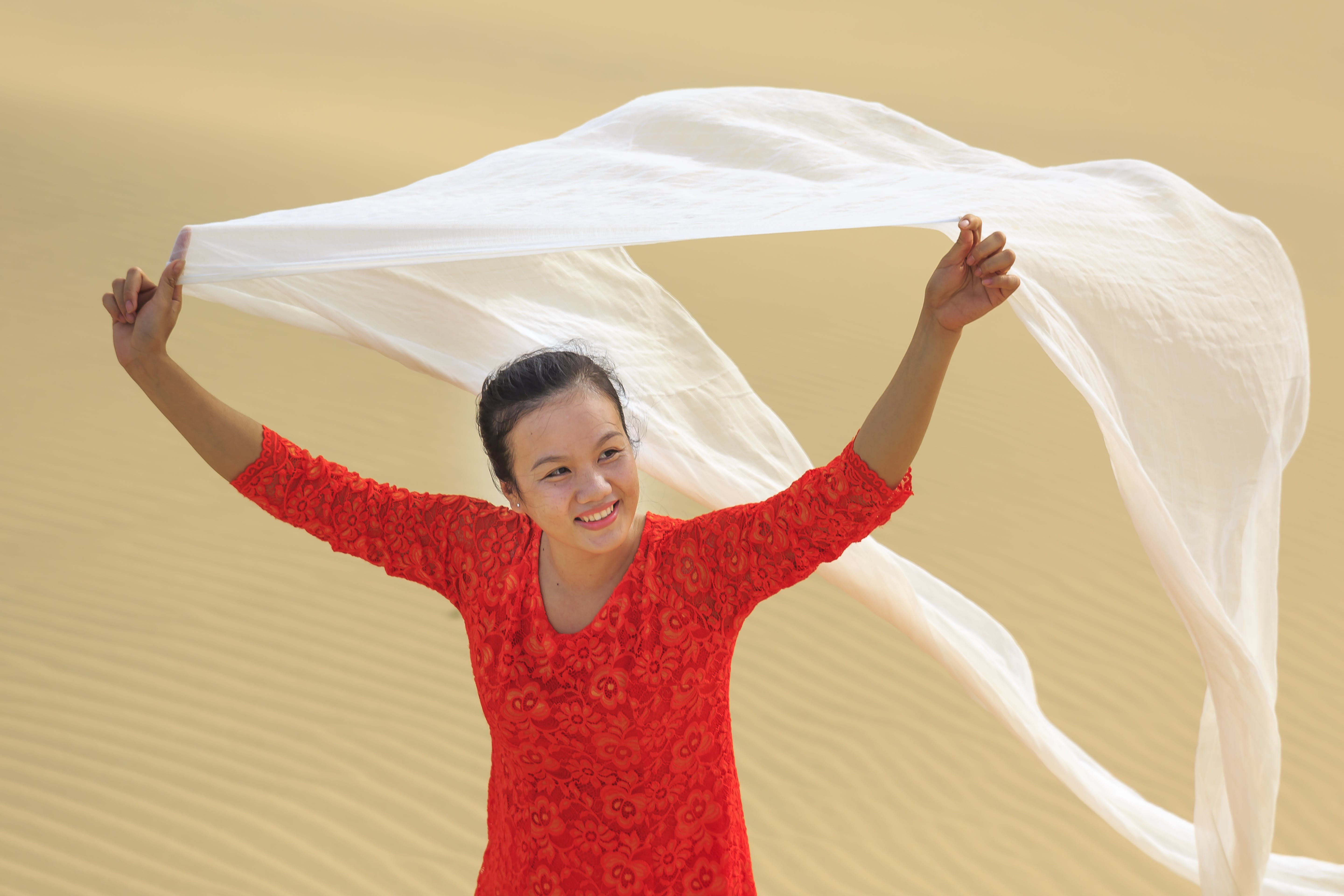 Woman Holding White Scarf At The Desert
