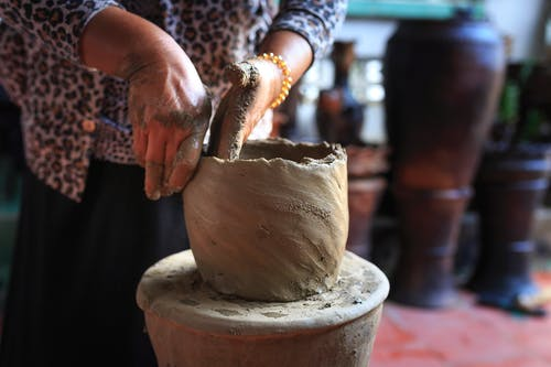 Person Molding Clay Pot