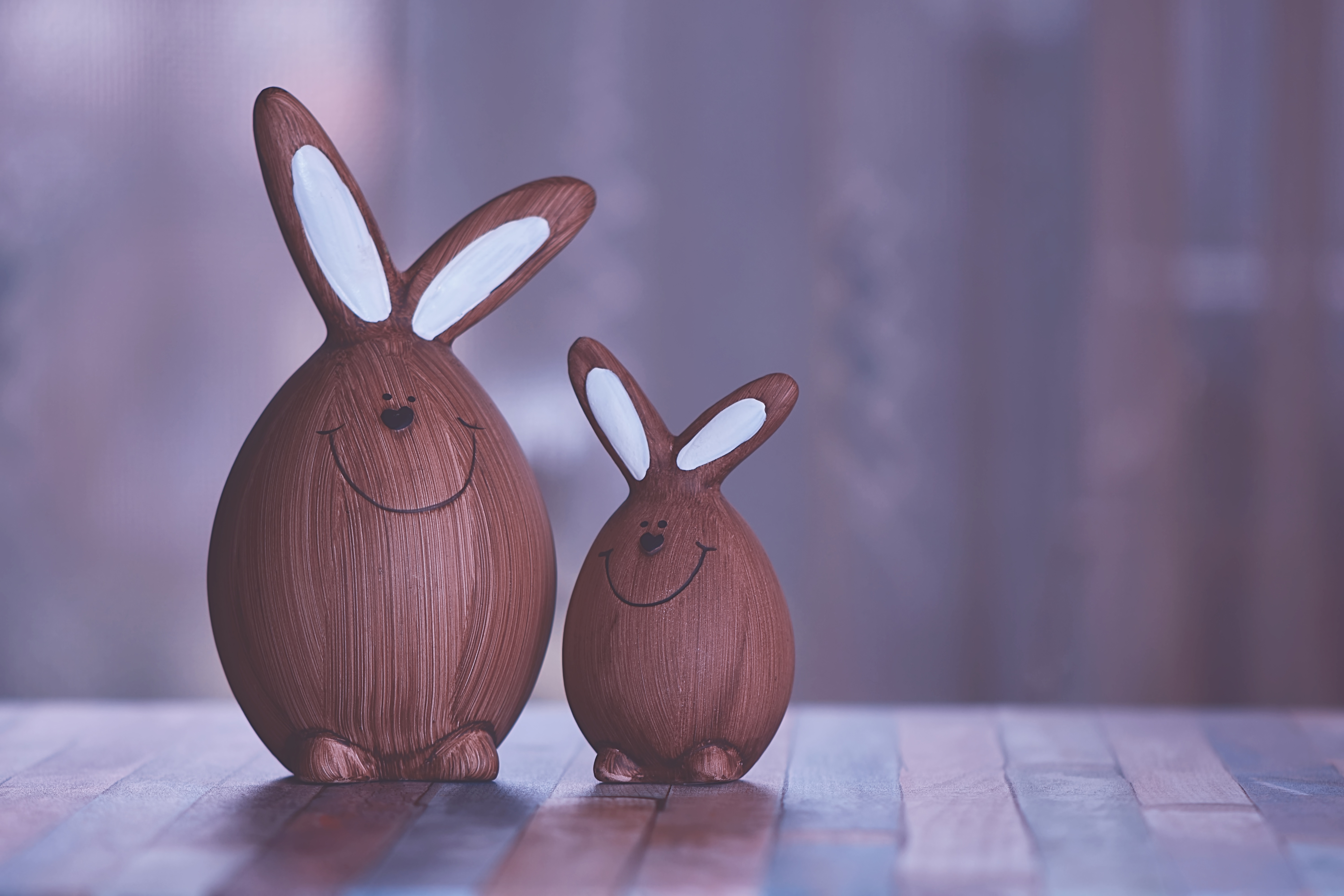 two brown and white rabbit figurines