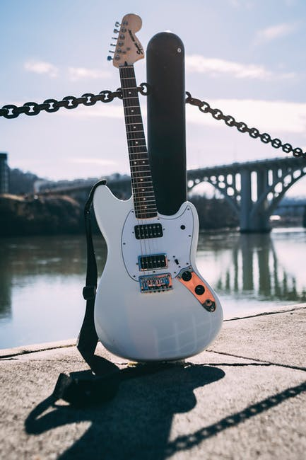 Photo of guitar near river
