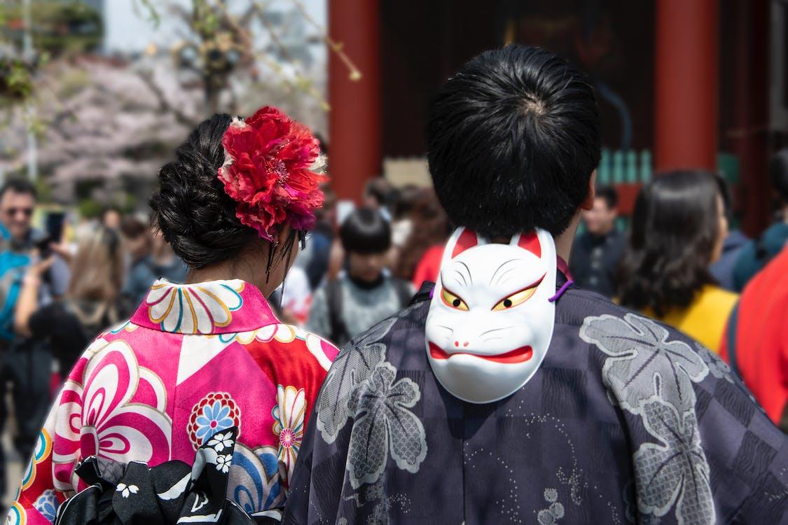 White Mask Behind Man's Head