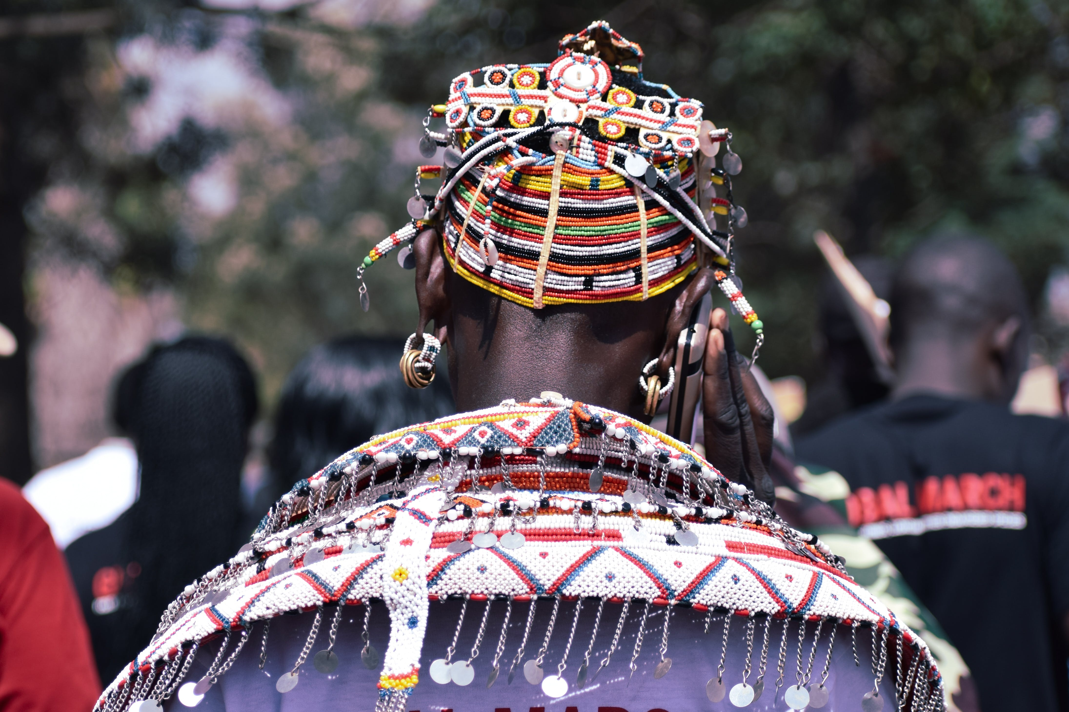 Back View of Person Wearing Beaded Headpiece