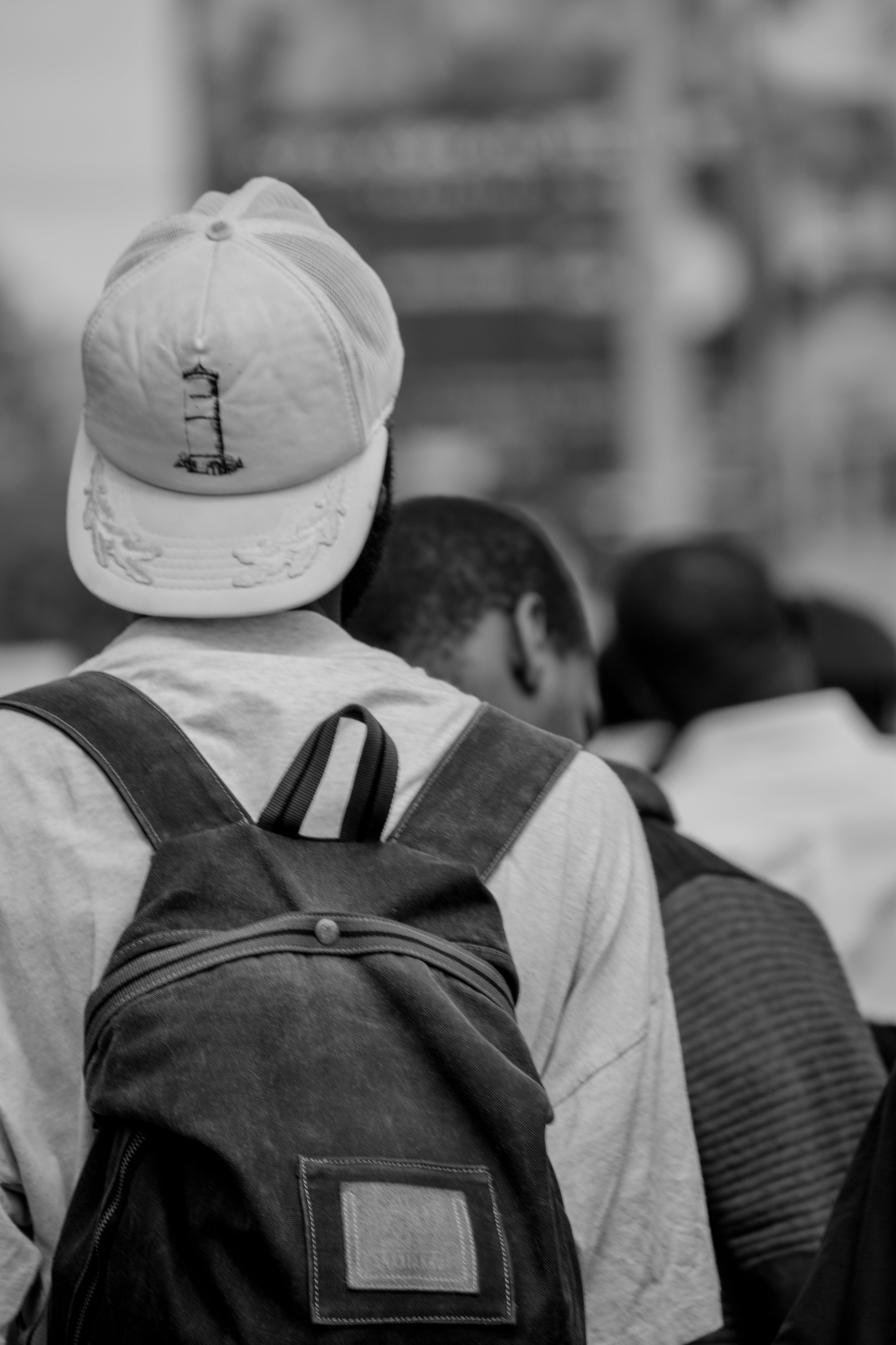Grayscale Photo Of Person Wearing Cap