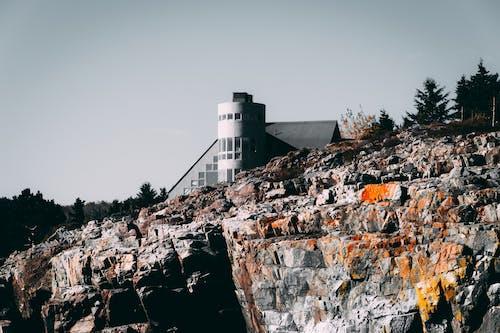 Gray House on Brown Rocks