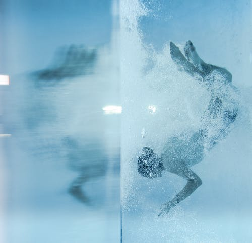 Person Diving Under Water