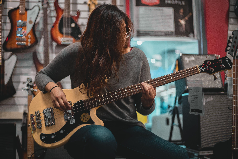 Woman Playing Bass Guitar
