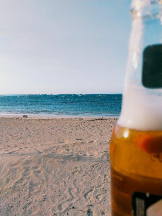 Beverage Bottle on Seashore