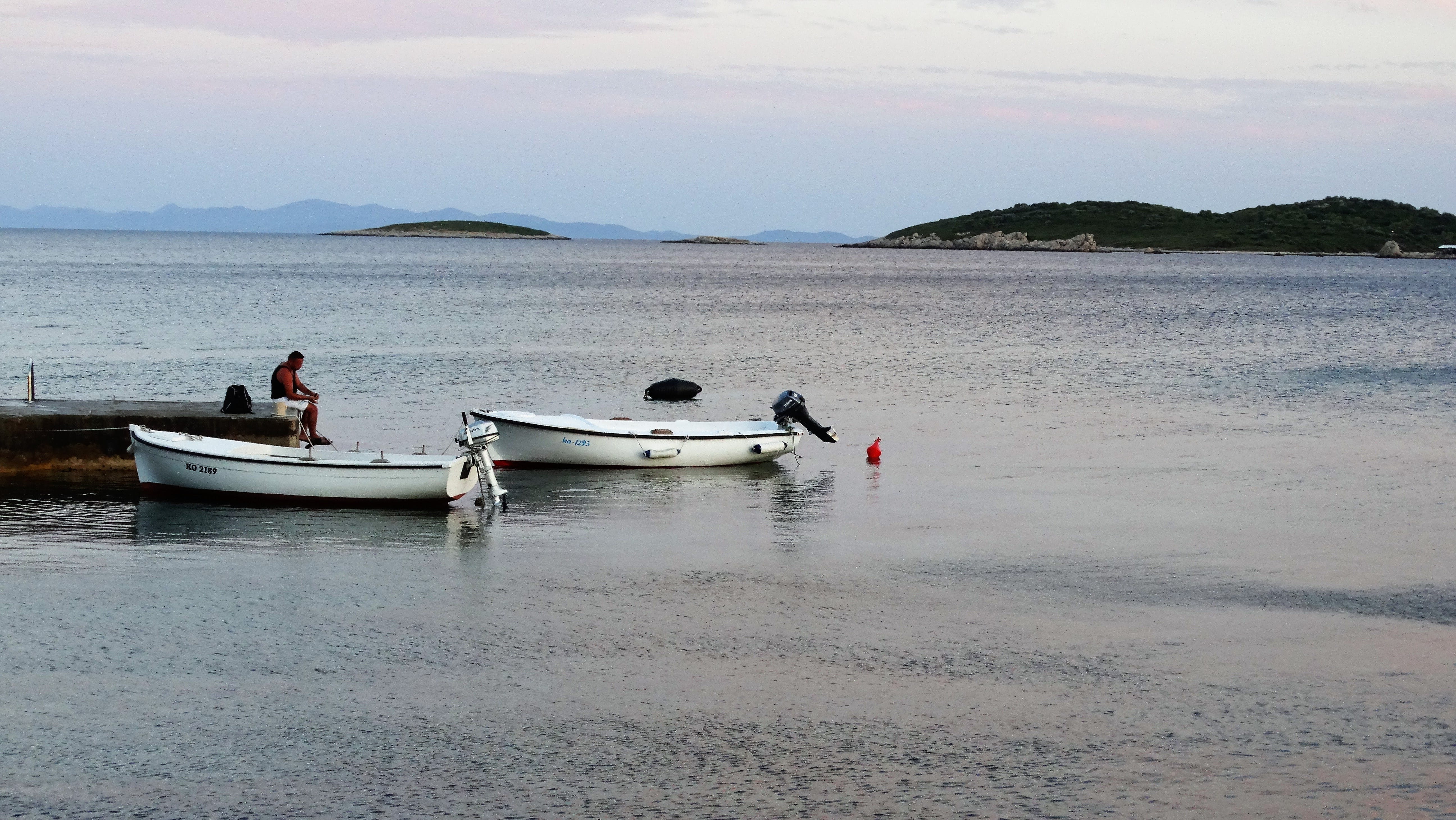 2 White Boat on Beach during Daytime