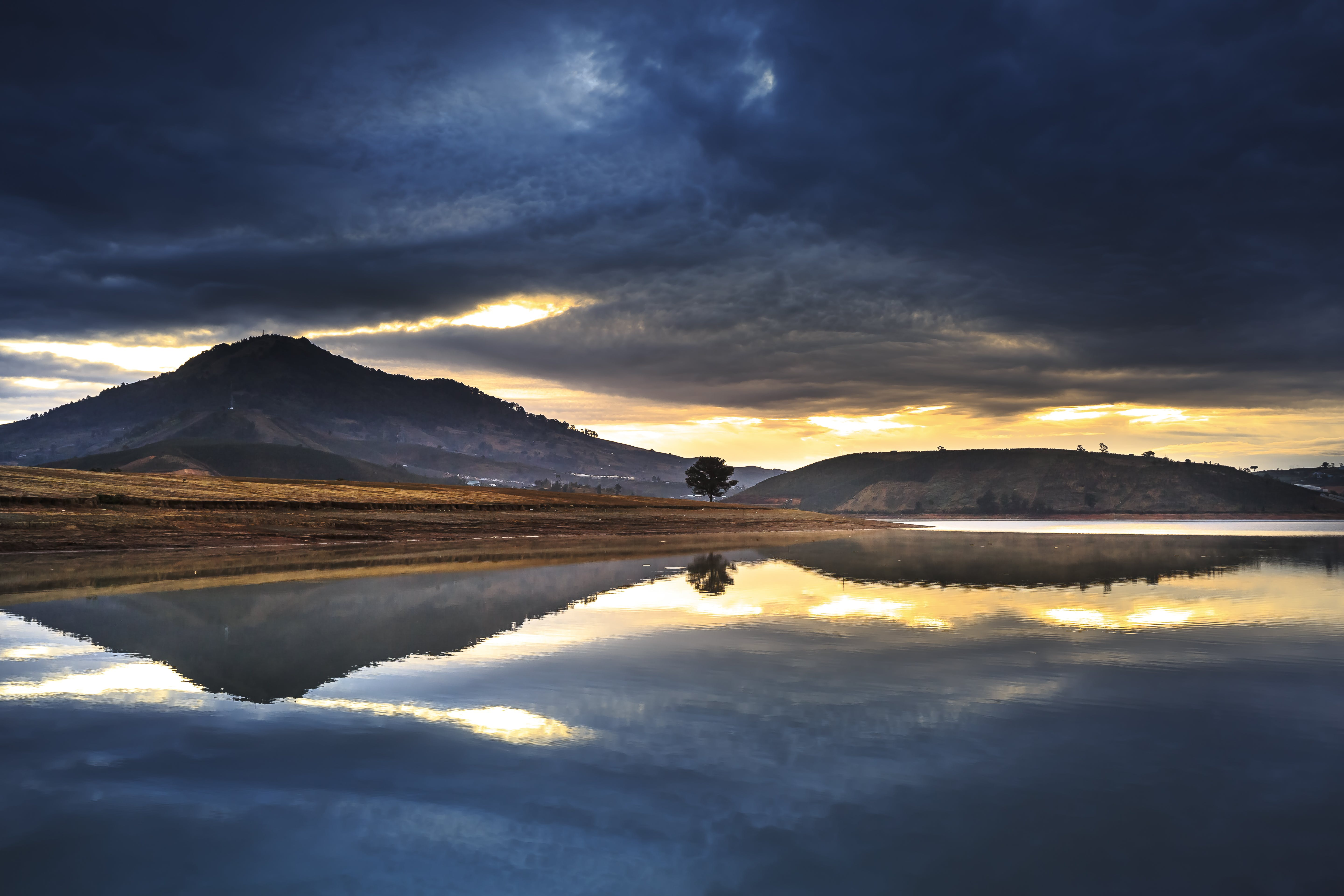 Mountain Reflection on Body of Water