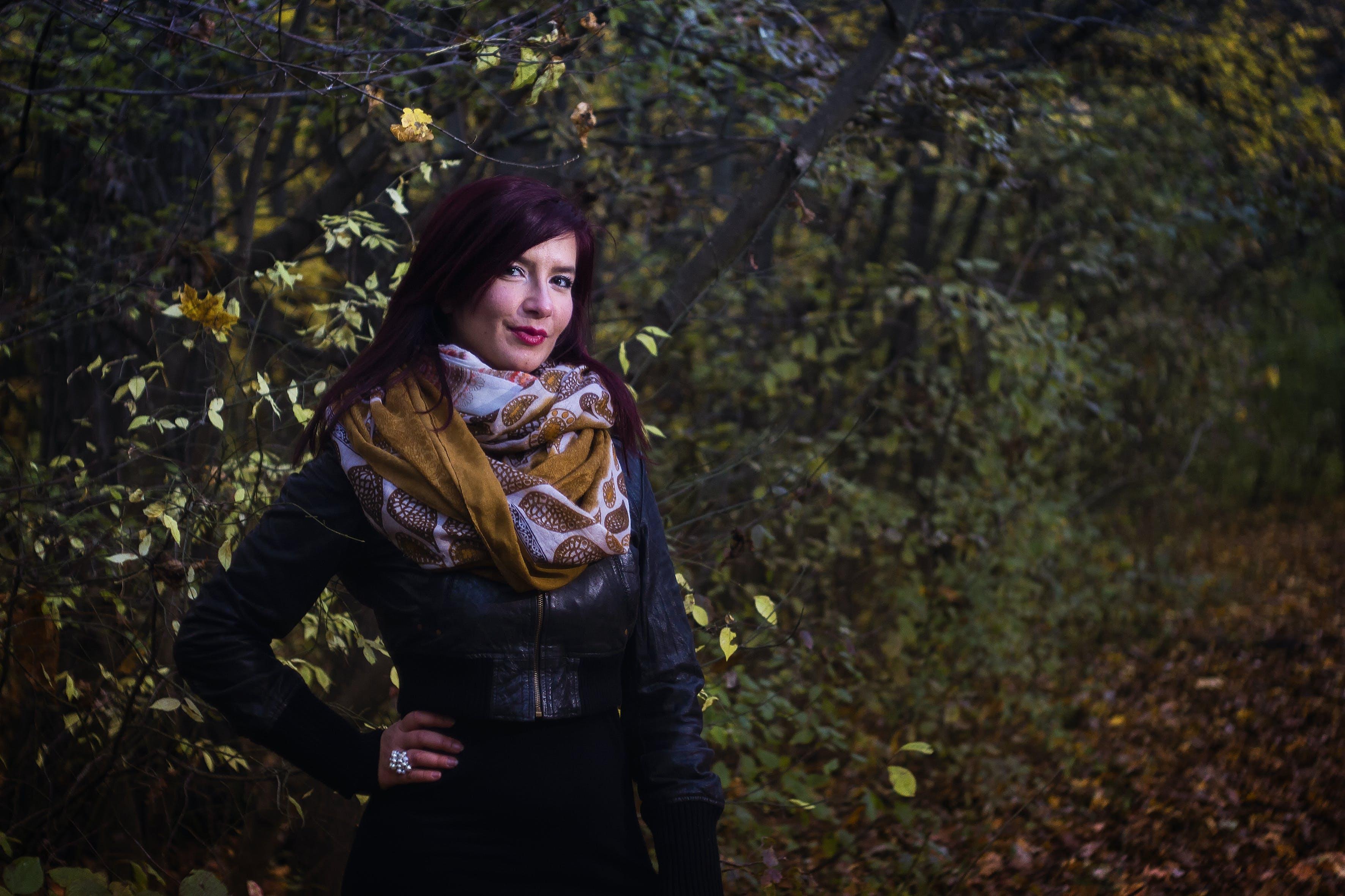 Woman in Black Leather Jacket Beside Trees