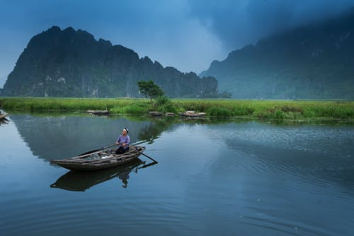 Person Riding Boat