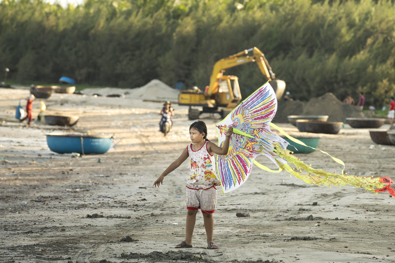 Безкоштовне стокове фото на тему «веселий, гра, дитина, пісок»