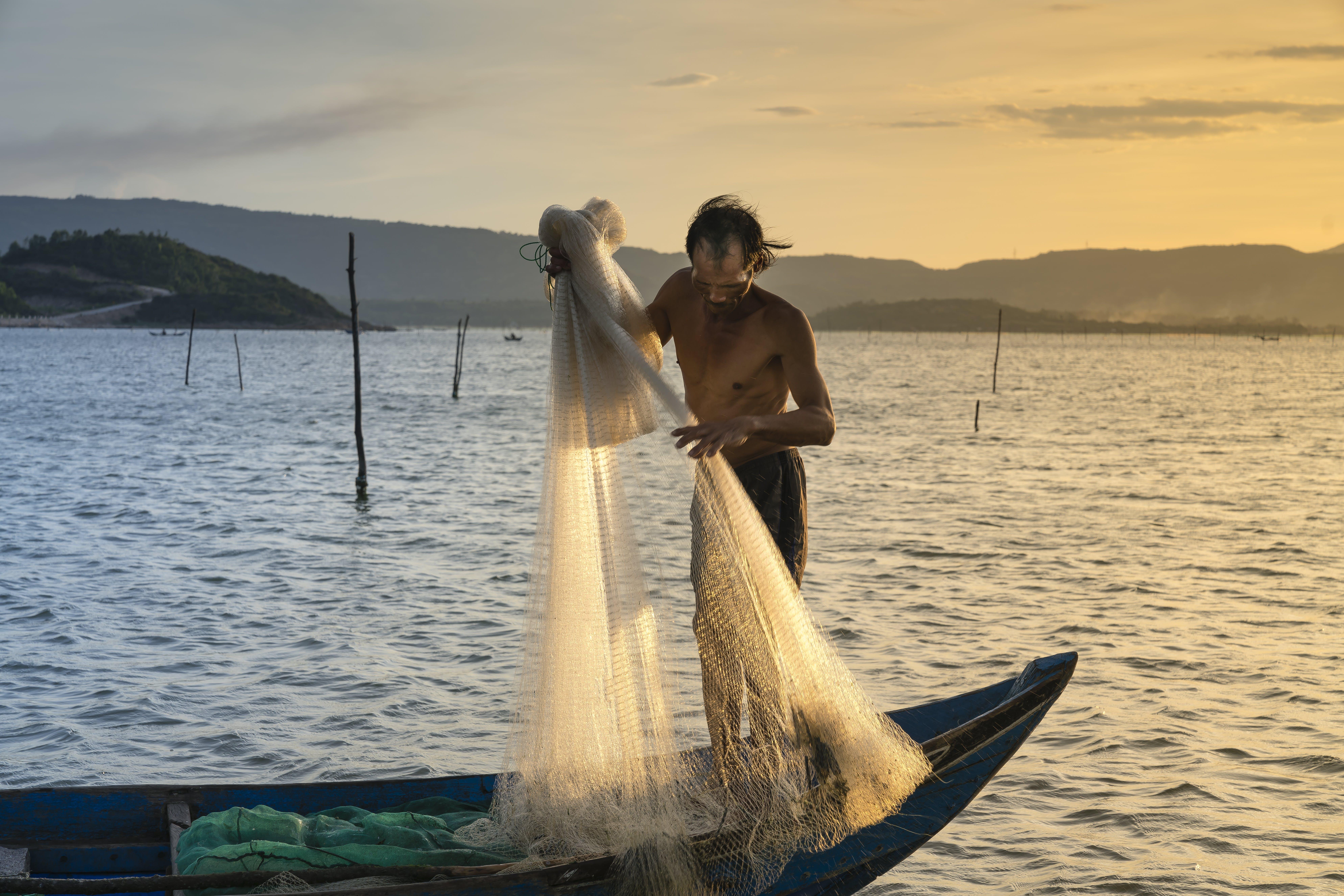 Ingyenes stockfotó Férfi, hajnal, halász, Napkelte témában