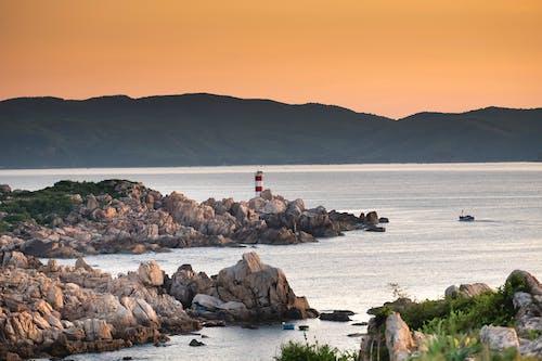 Foto d'estoc gratuïta de alba, capvespre, far, illa