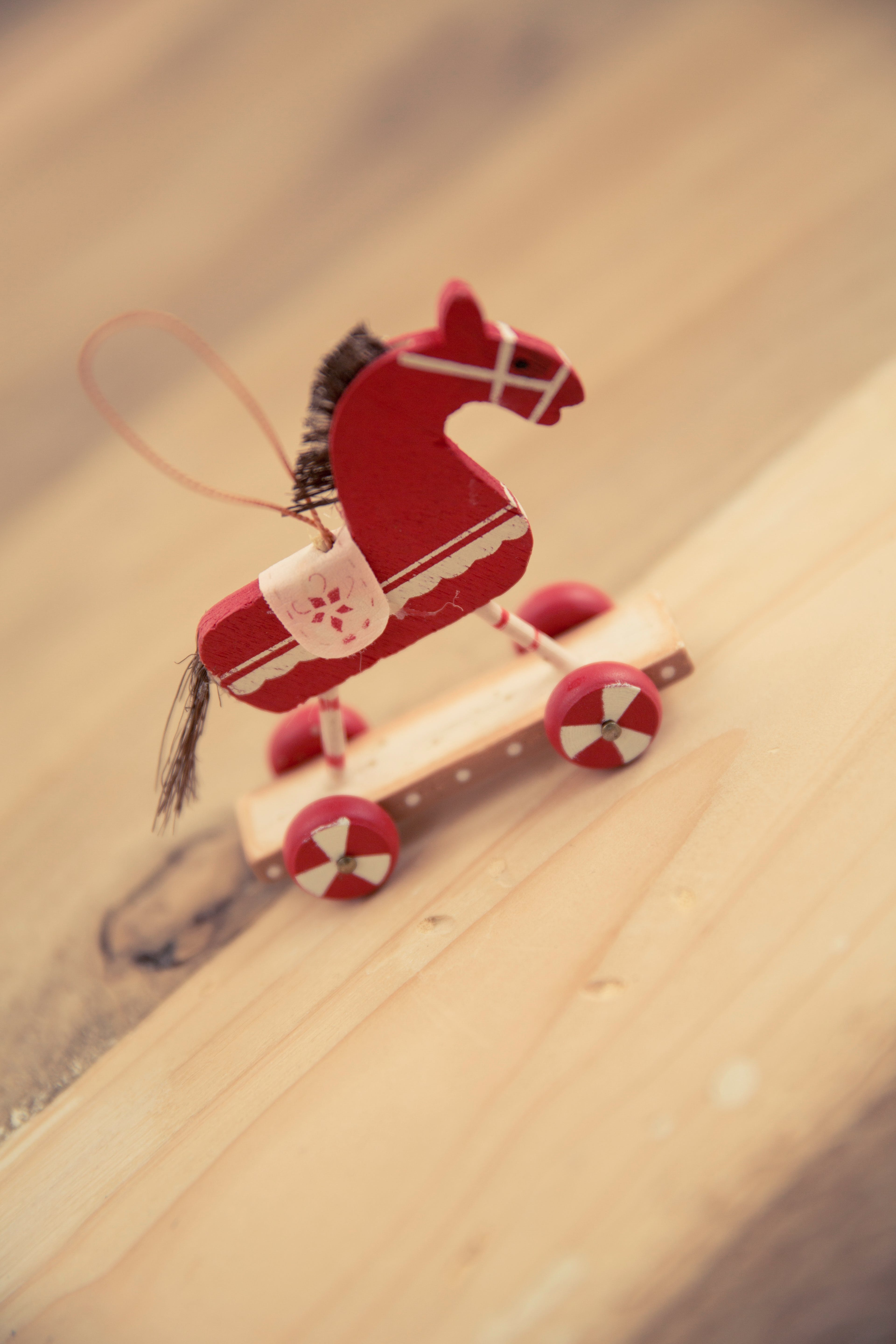 Red and White Wooden Horse Decor