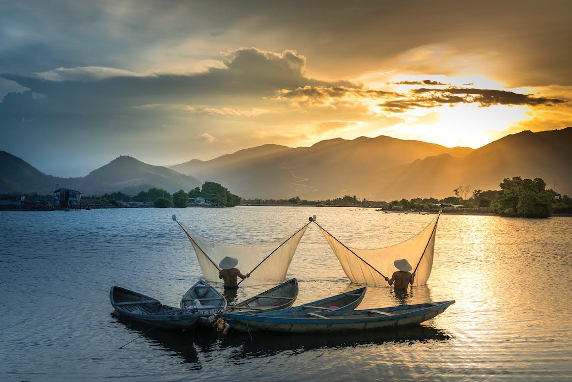 Men On Water Spreading Nets
