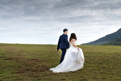 Photo of Couple On Grass Field