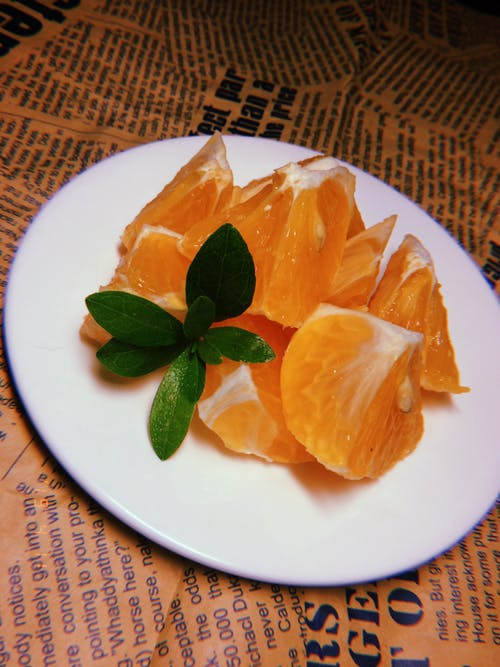 Photo of  Sliced Orange Fruit On Plate