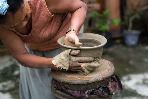 Woman Making Clay Jar
