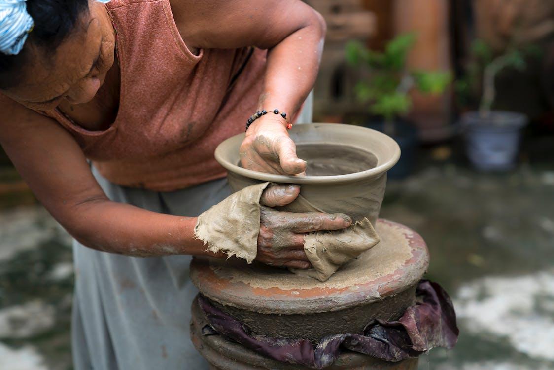Woman Making Clay Jar