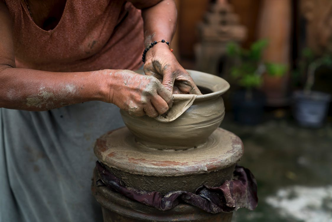 Woman Making Clay Pot
