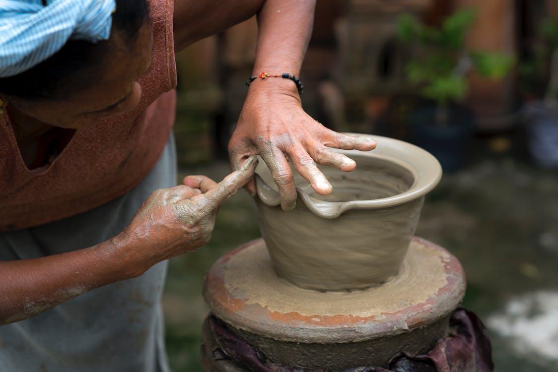 Woman Moldin Pot