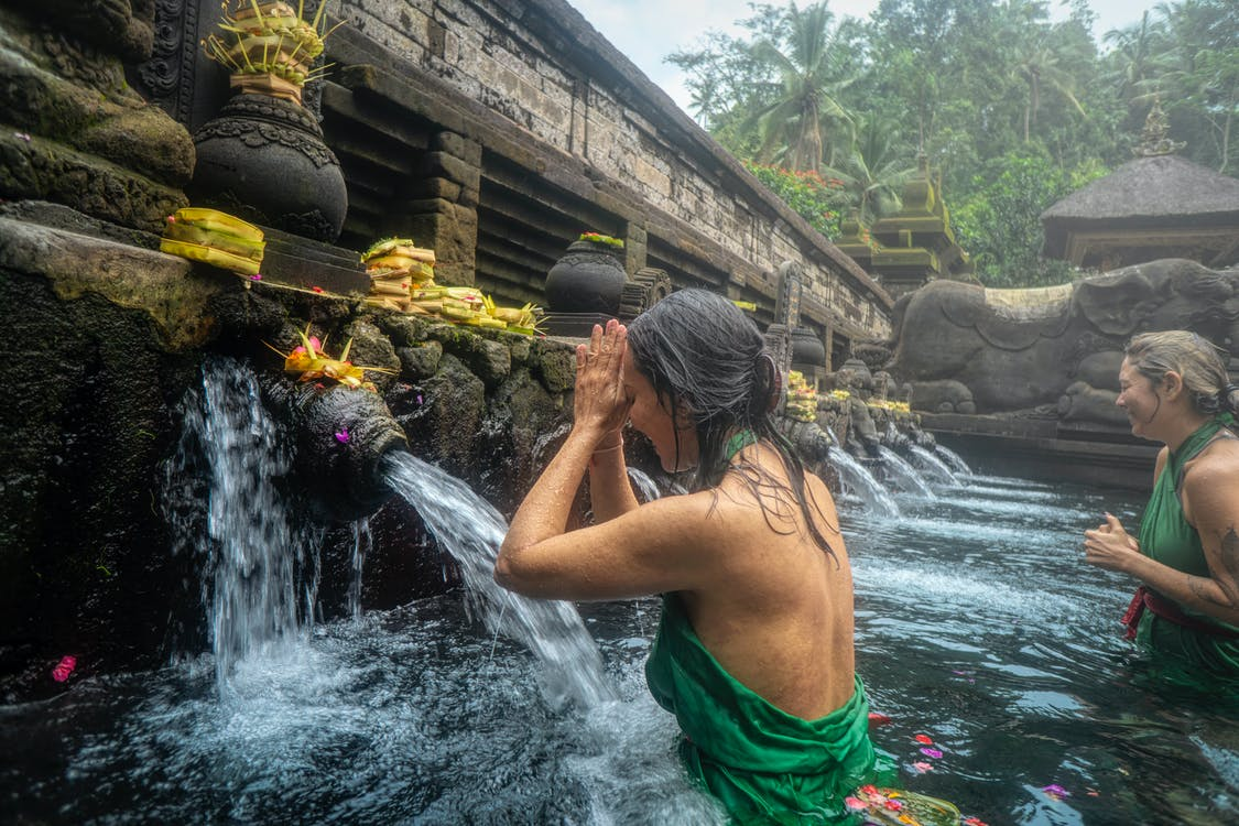 Woman Standing in Front of Flowing Water