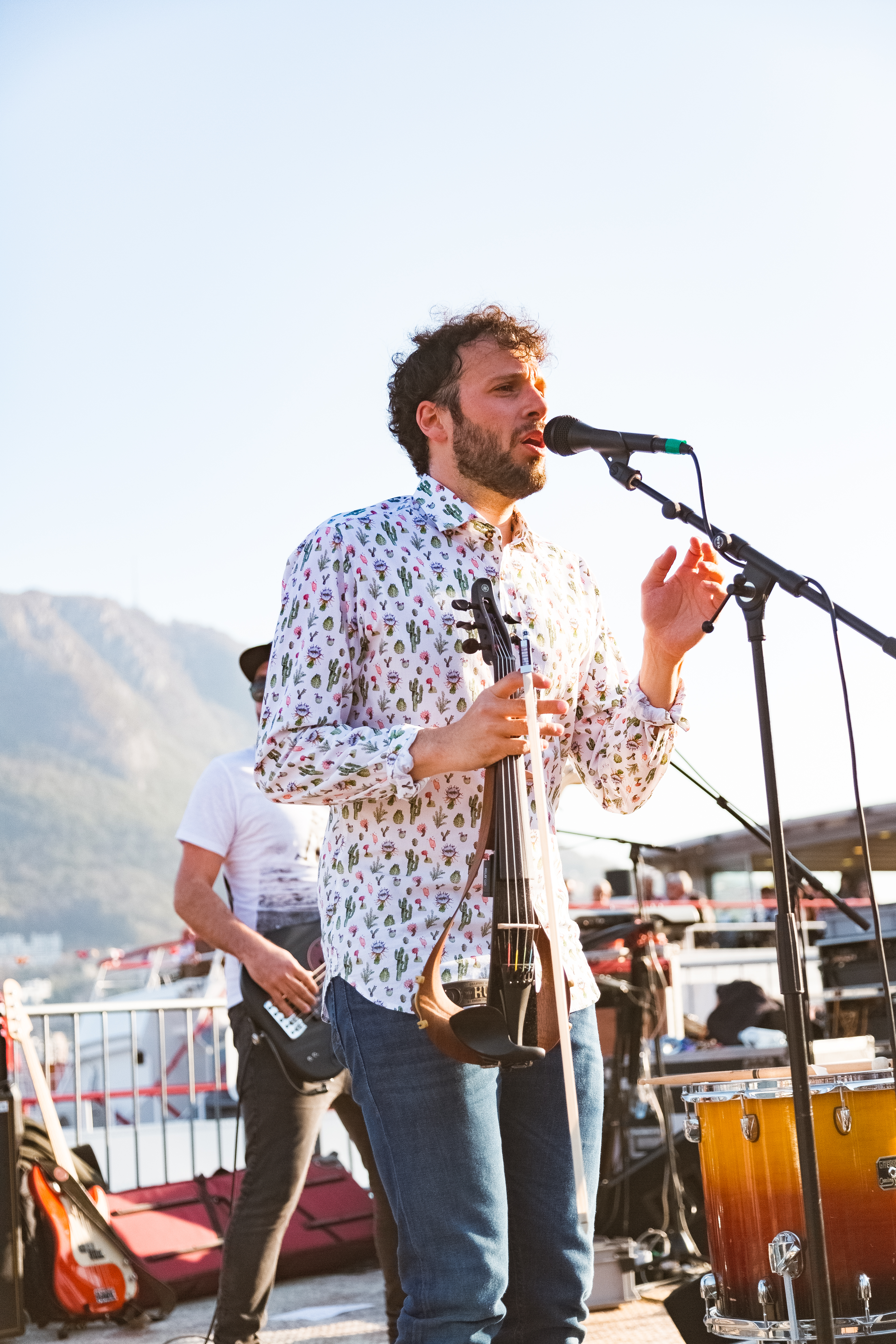 Photo of a Man Singing on Stage