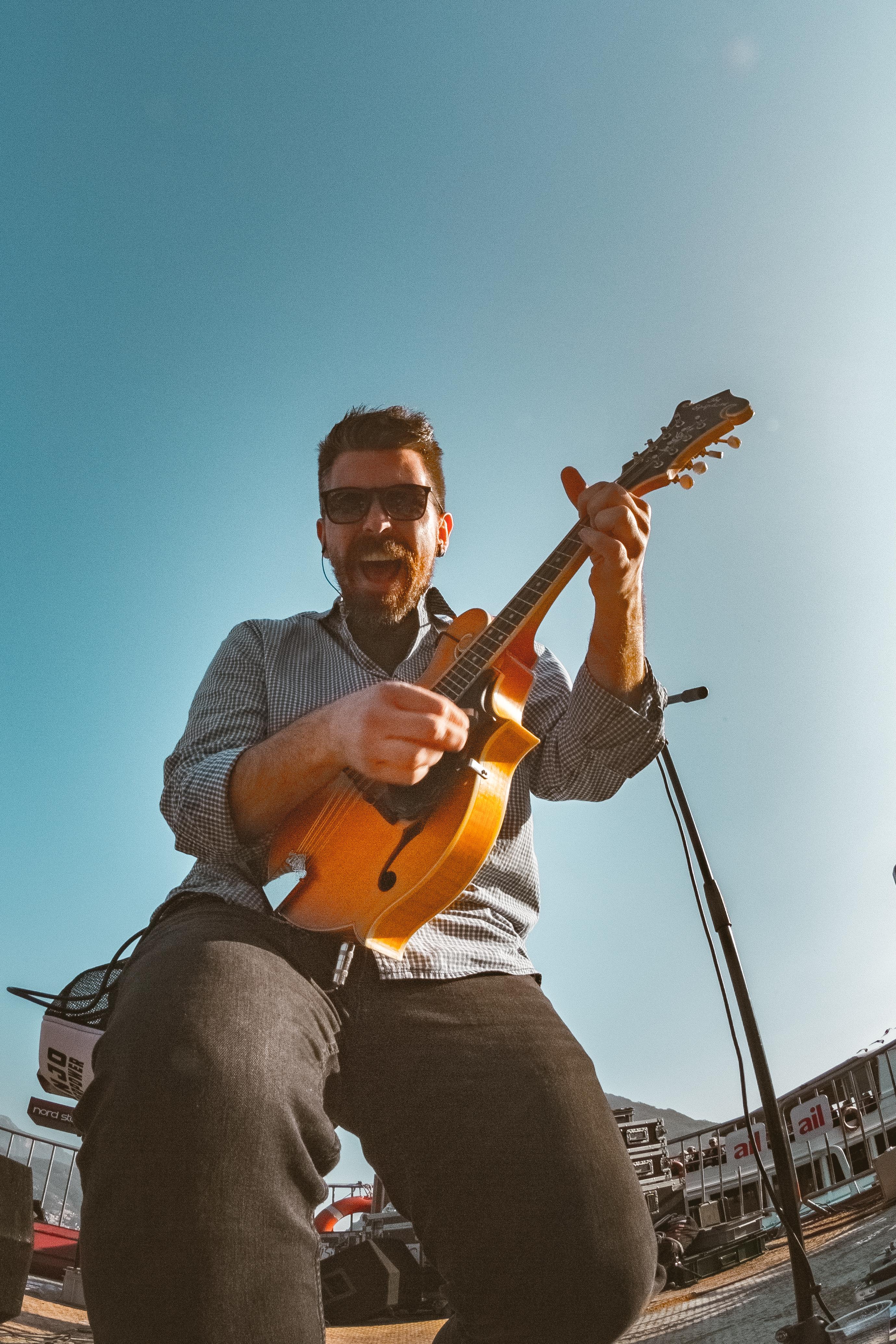 Man in Sunglasses Playing Jazz Guitar