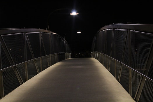 Gray Beige Bridge during Night Time