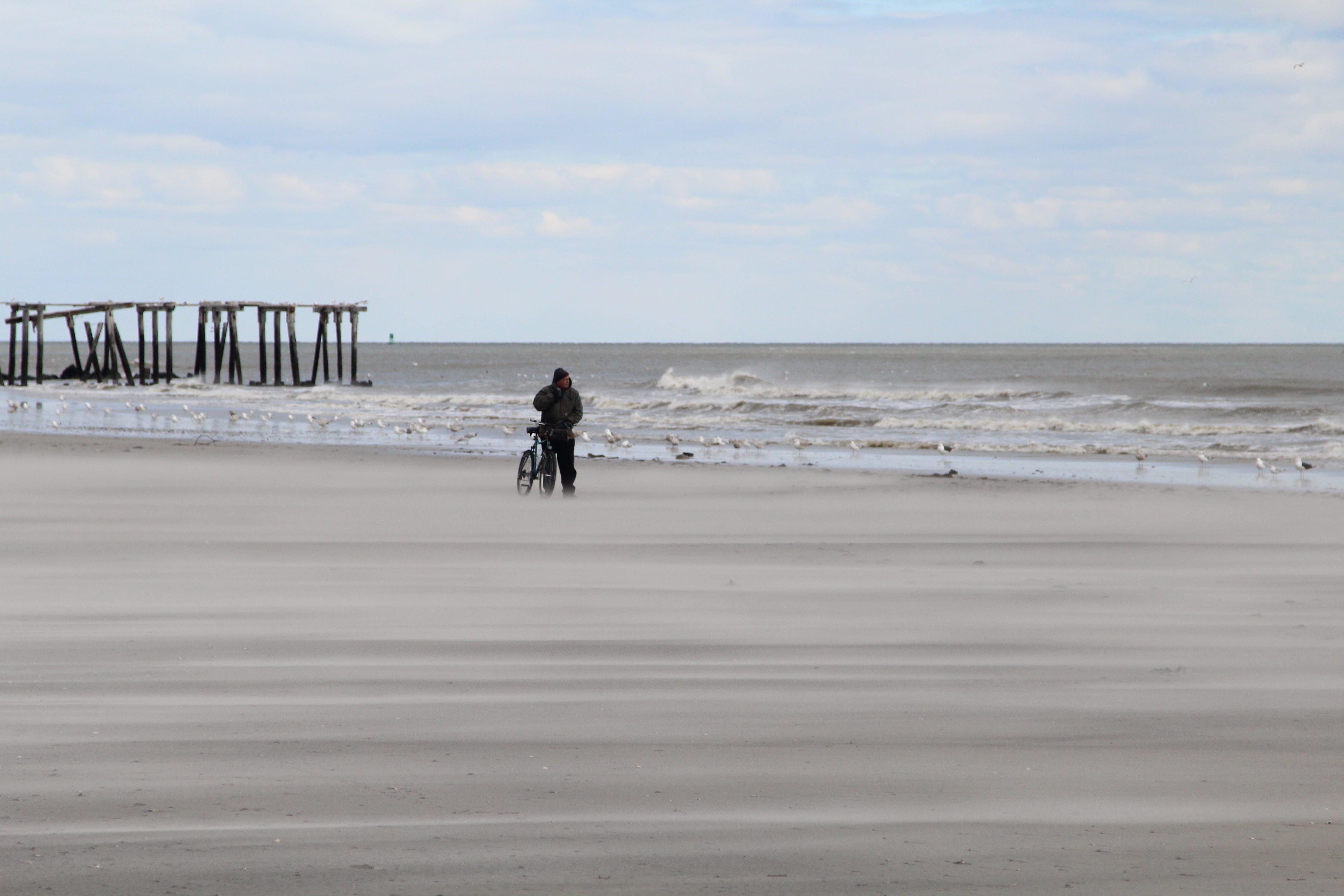 Free stock photo of beach, bike, man, sand