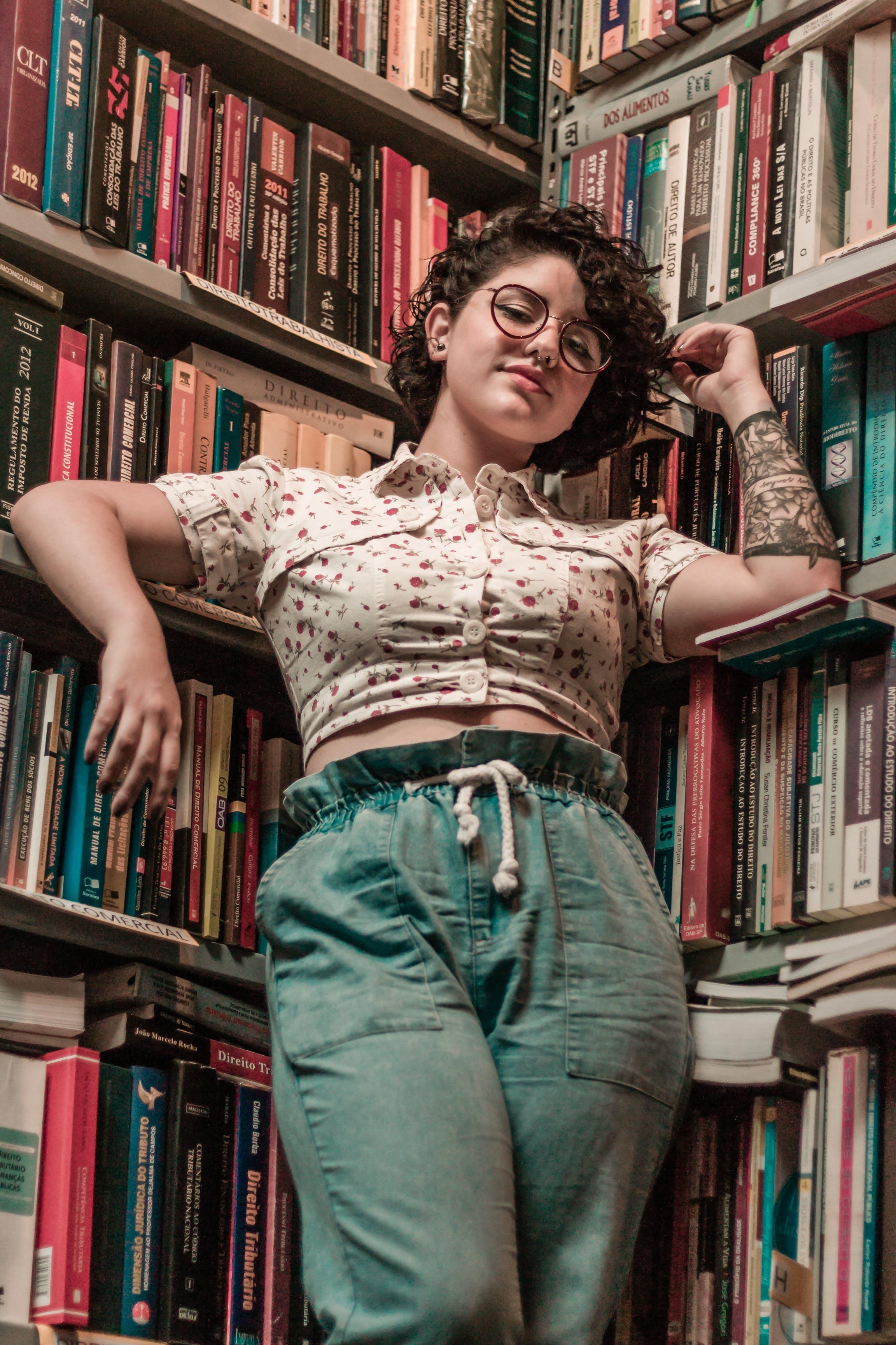Woman Leaning on Bookshelf