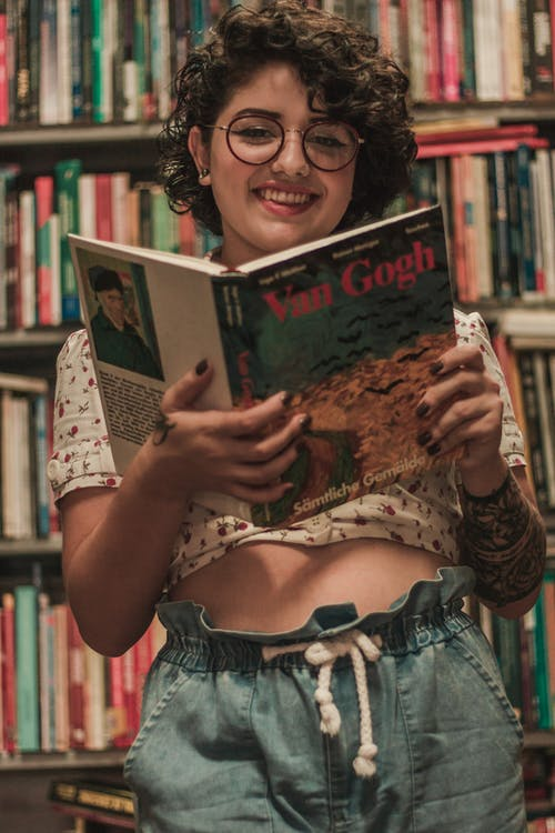 Smiling Woman While Reading Book