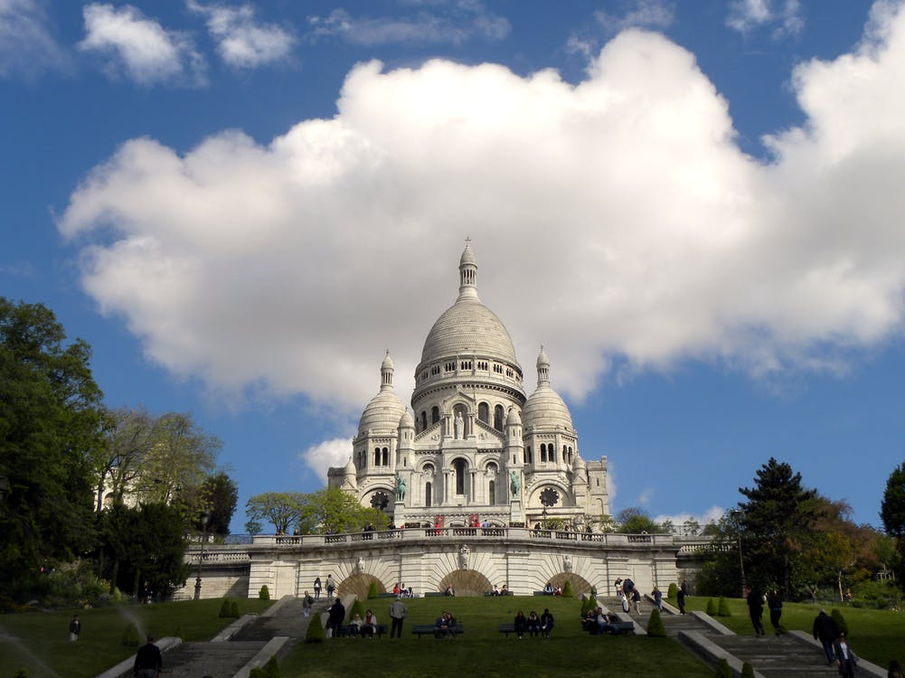 White Concrete Dome Building Under White Clouds and Blue Sky