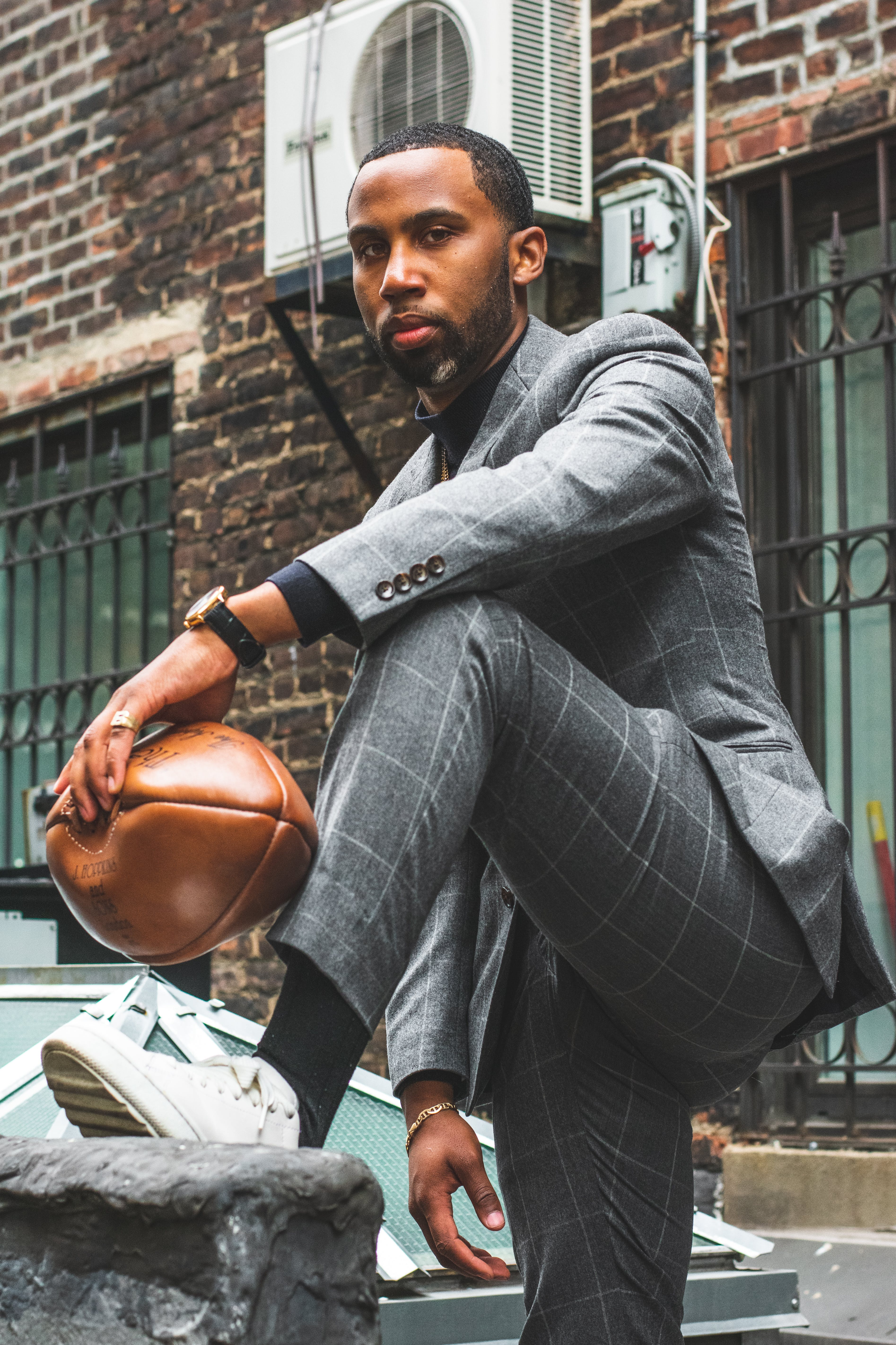 Photo of Man in Formal Wear Holding Football